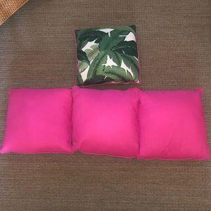 3 hot pink pillows